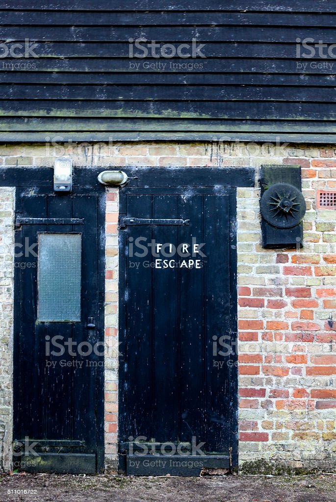 Fire Exit At A Watermill stock photo
