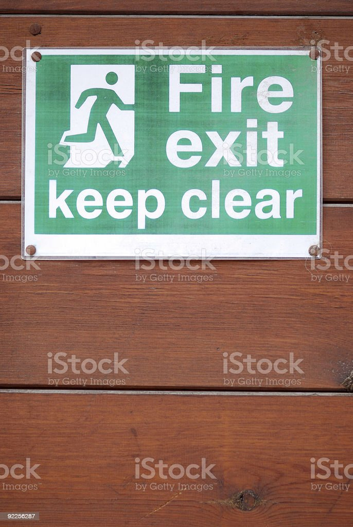 Fire exit keep clear green sign stock photo