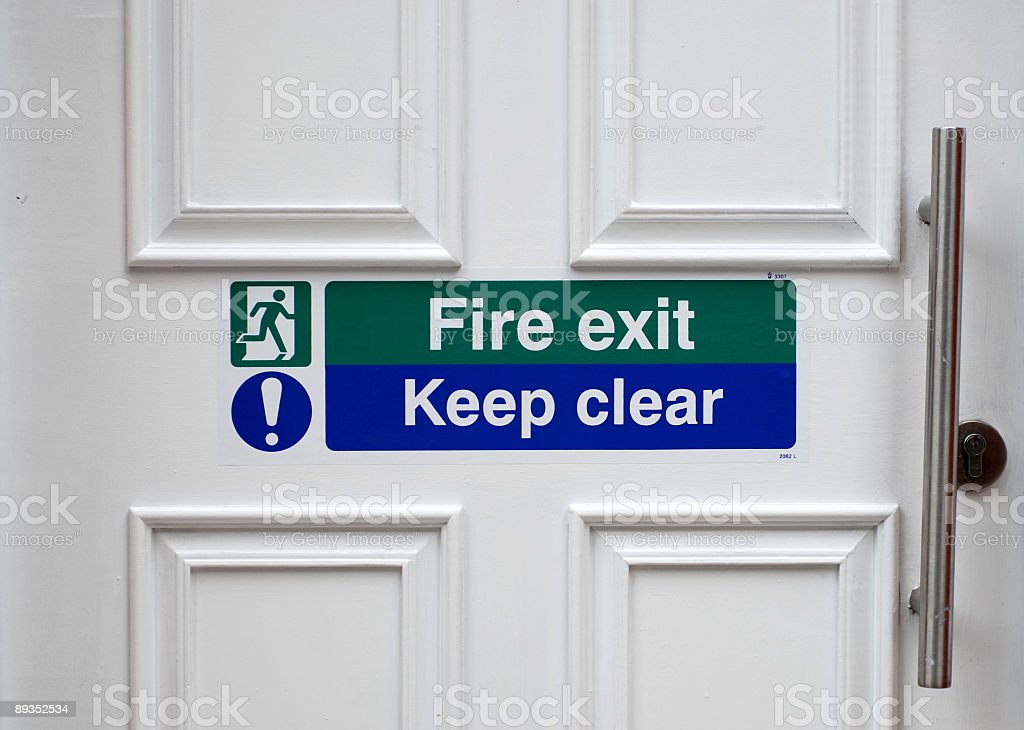 Fire exit - Keep clear sign on door stock photo