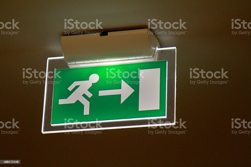 Fire Exit sign hanging from ceiling stock photo