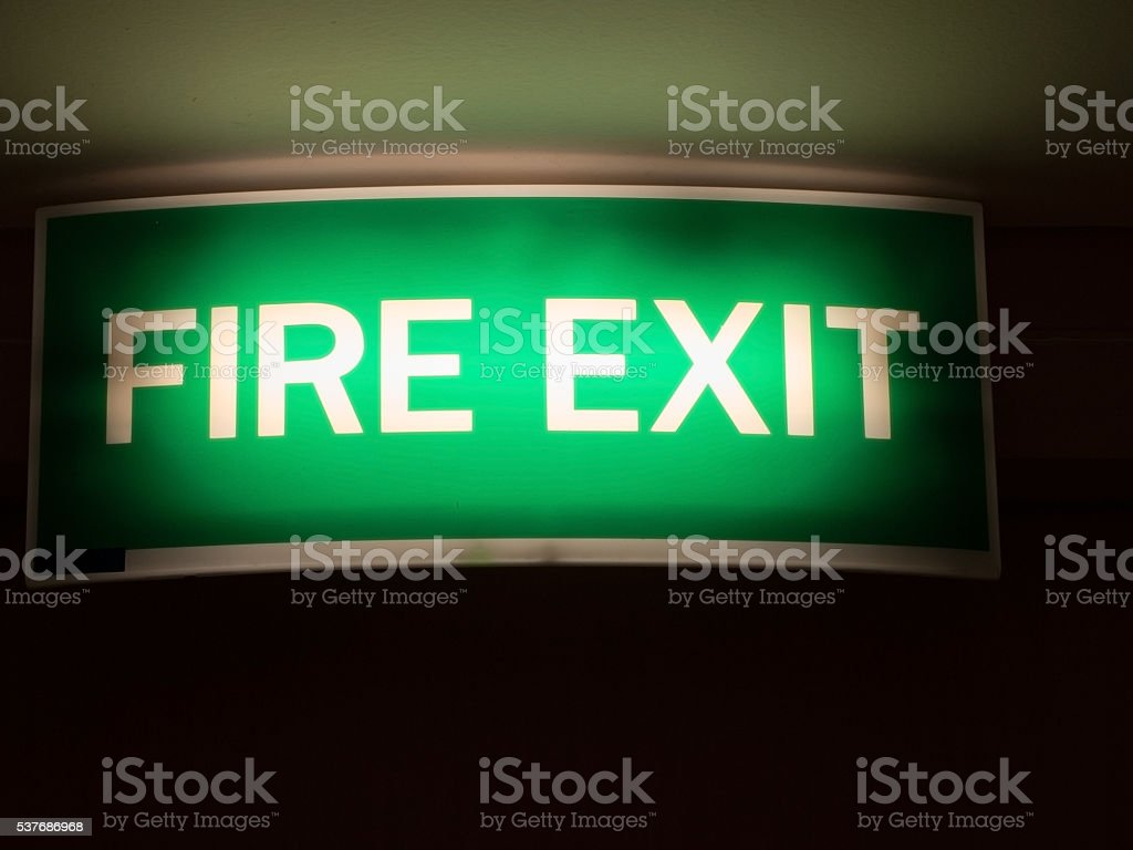 Fire exit sign. Light green emergency fire exit sign stock photo