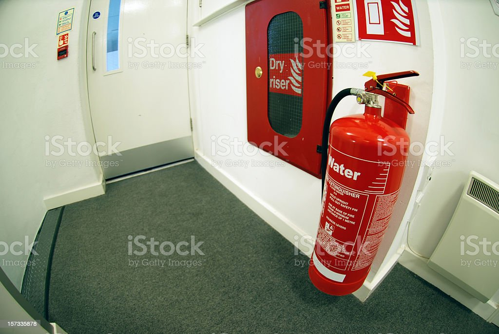 Fire extinguisher and emergency exit fisheye royalty-free stock photo