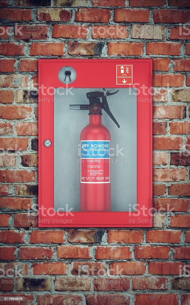 Fire extinguisher in wall box. brick wall stock photo