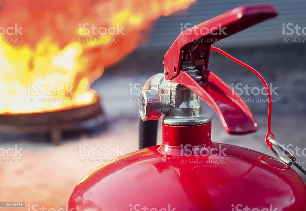 Fire extinguisher ready for use stock photo