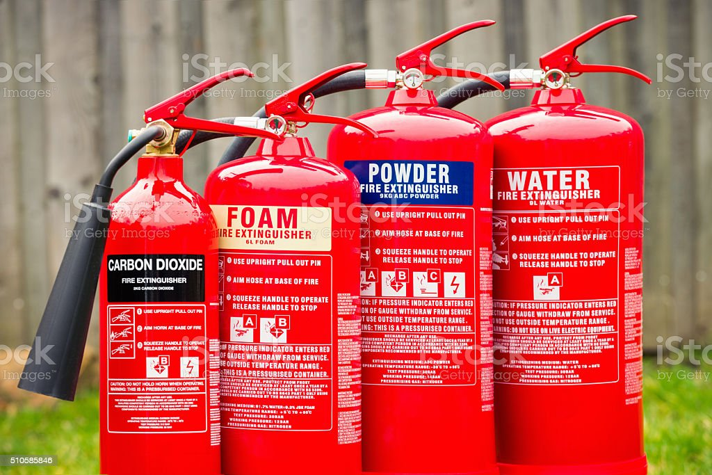 Fire extinguishers: Carbon dioxide, foam, powder and water stock photo