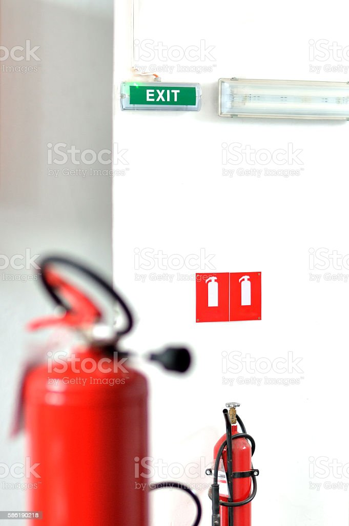 Fire Extinguishers, Sign for a Fire Extinguisher and Exit Sign stock photo