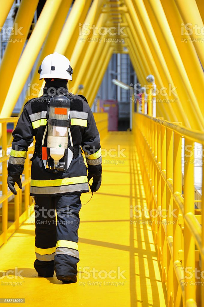 Fire fighter on oil and gas industry, successful firefighter stock photo