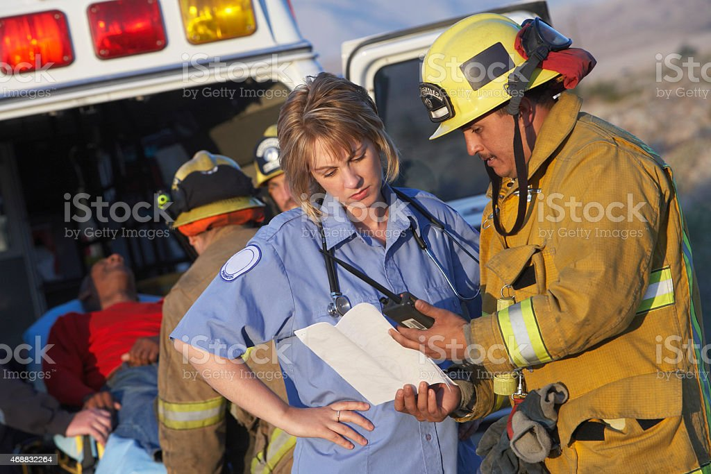 Fire Fighters and Paramedics stock photo