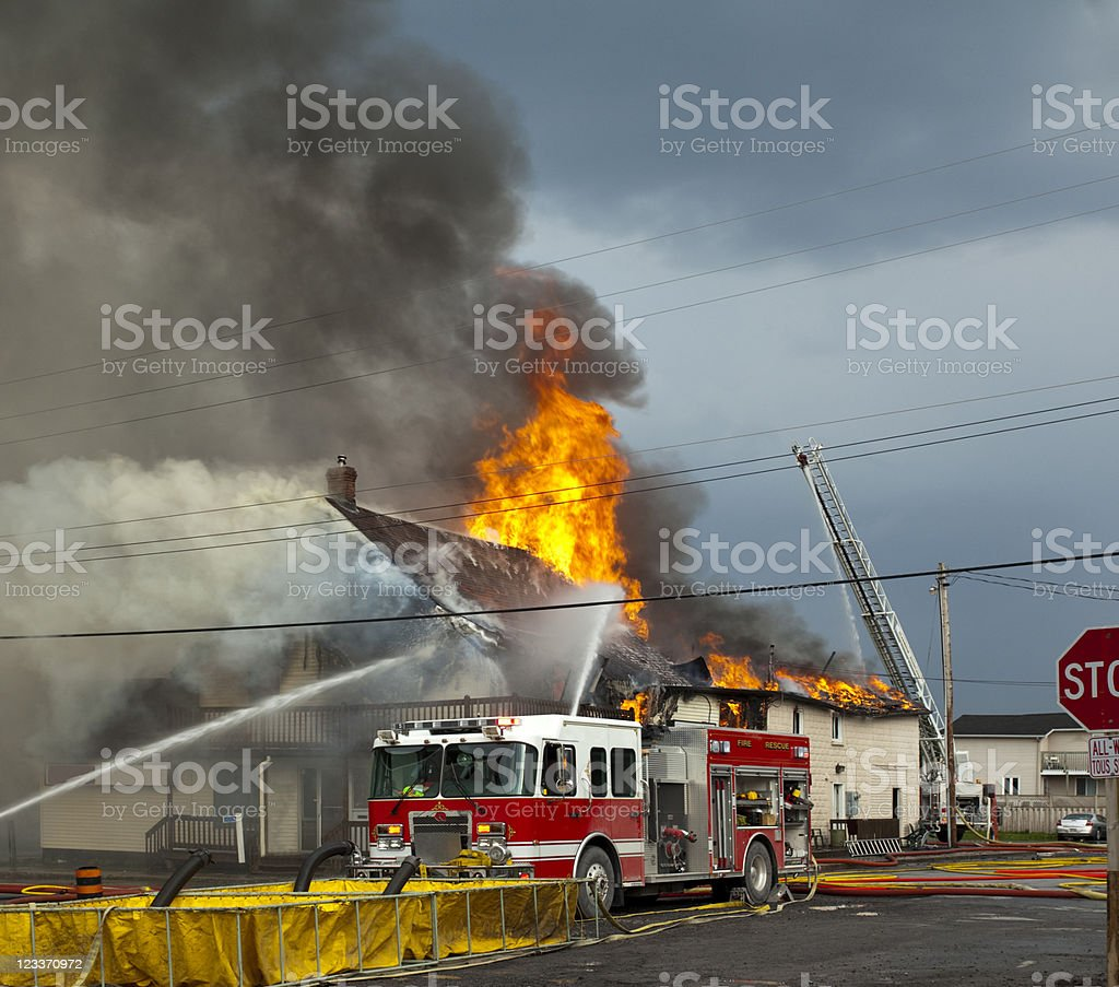 fire fighters fighting blaze stock photo