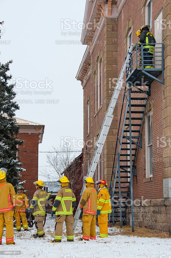 Fire Fighters Practice Rescue in Snow stock photo