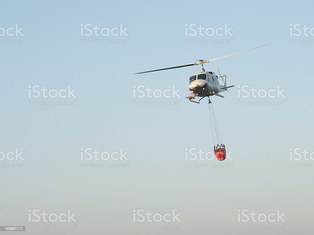 Fire fighting helicopter about to drop water stock photo