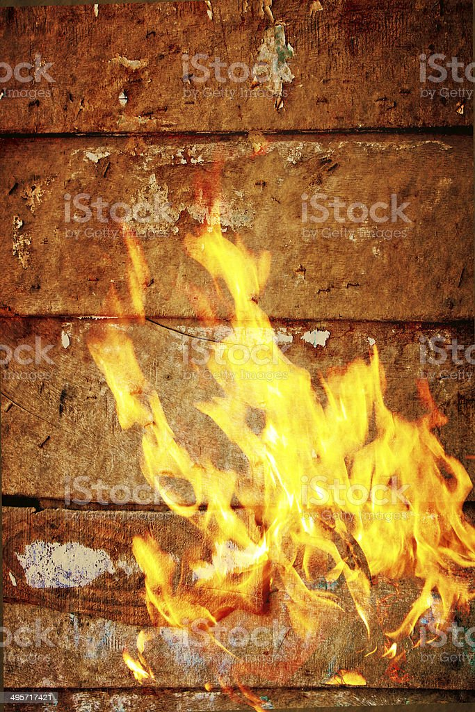 fire flame burns,wood plank background royalty-free stock photo