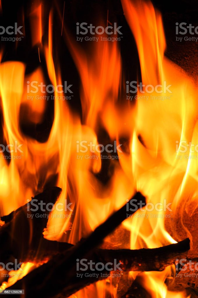 Fire flames on a black background. Blaze fire flame texture back stock photo