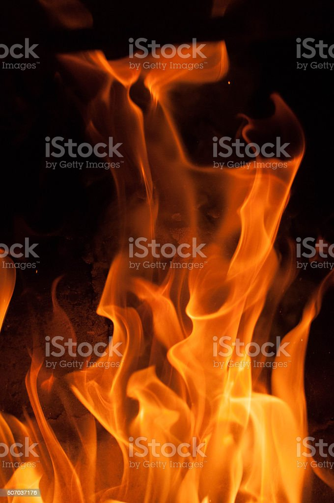 Fire flames on a black background. stock photo