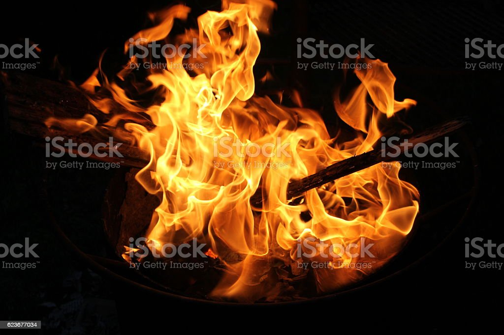 Fire flames on black background, fire in stove. stock photo