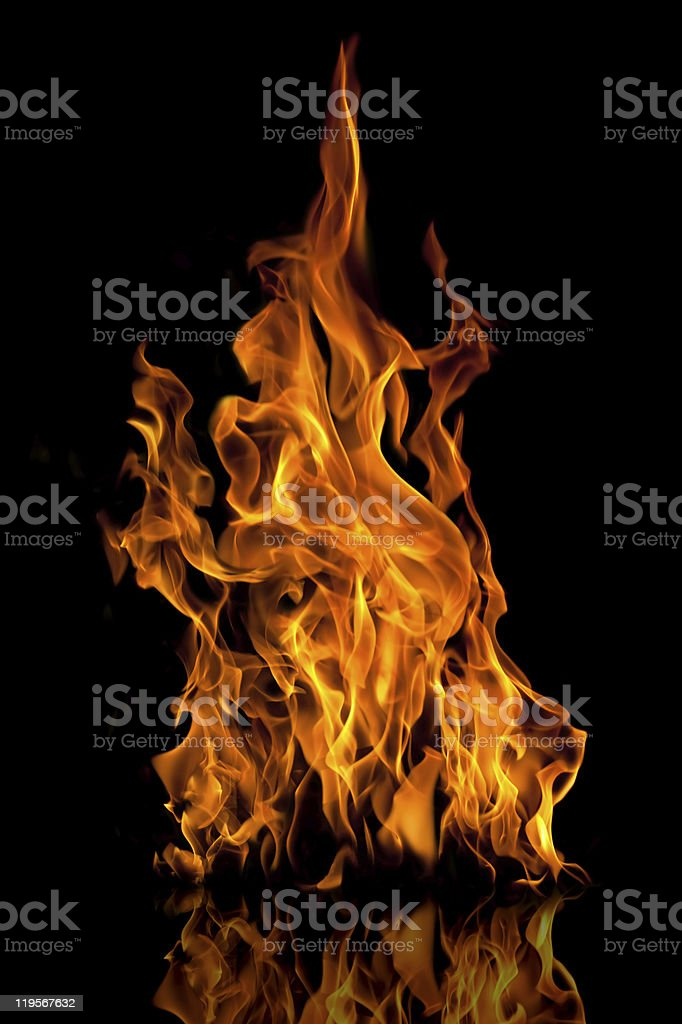 Fire flames reflected on black surface and background stock photo
