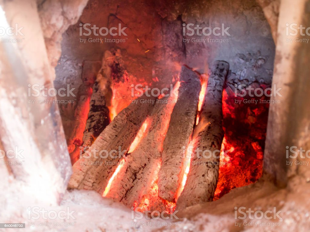 Fire from charcoal in ancient furnace. stock photo