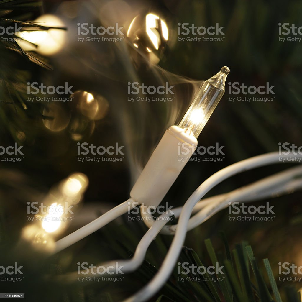Fire Hazard - Christmas Light Smoking stock photo