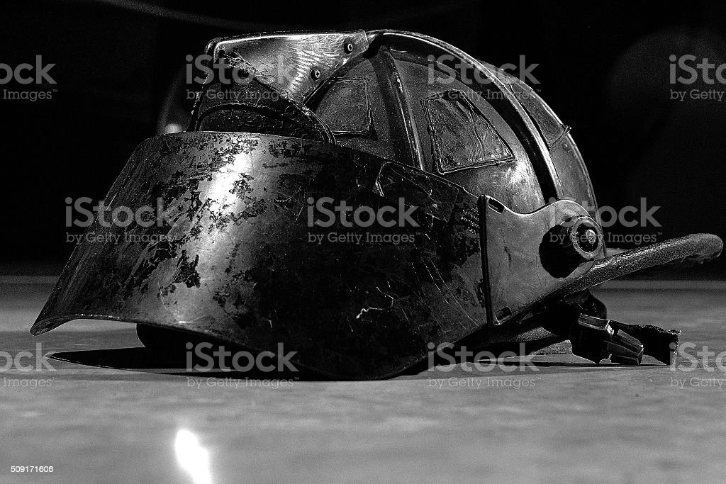 Fire helmet that has been burned during firefighting stock photo