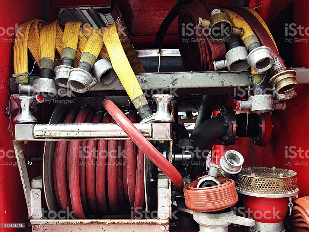 Fire hose and other equipment in a truck stock photo