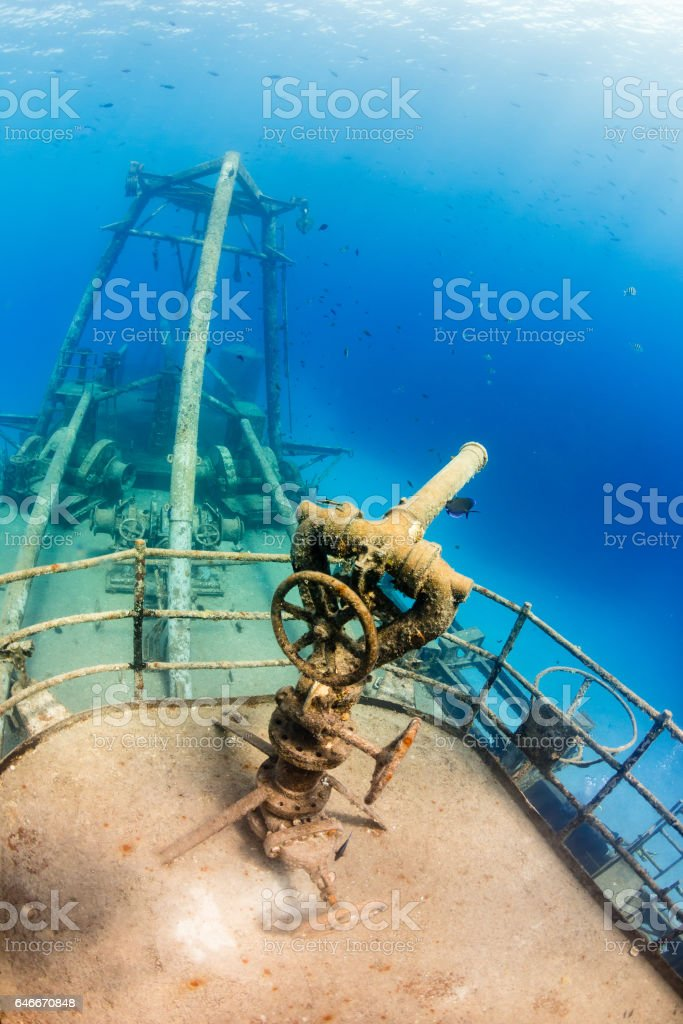 Fire hose apparatus on a large underwater shipwreck stock photo