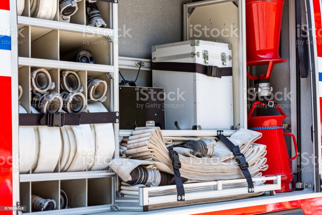 fire hoses and other fire fighting equipment on fire engine stock photo