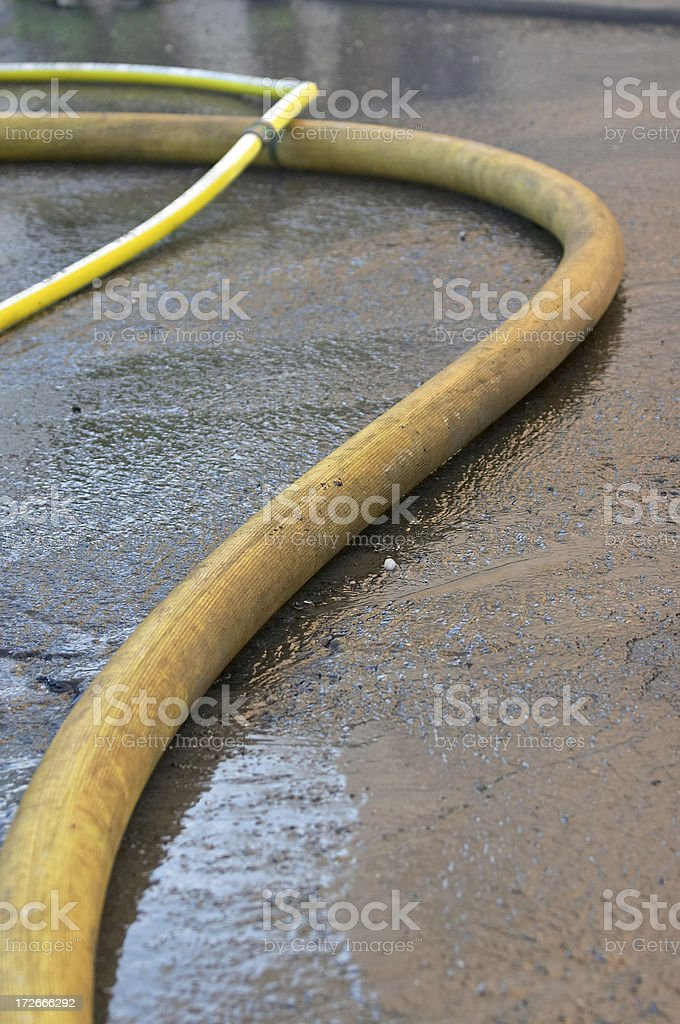Fire Hoses and run-off water - 1462 royalty-free stock photo