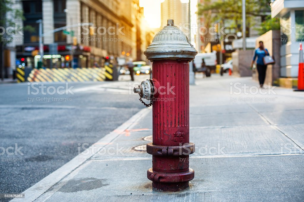 Old red fire hydrant in New York City street. Fire hydrant for...