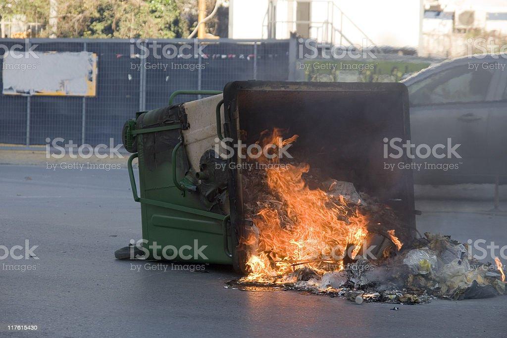 Fire in a garbage bin stock photo