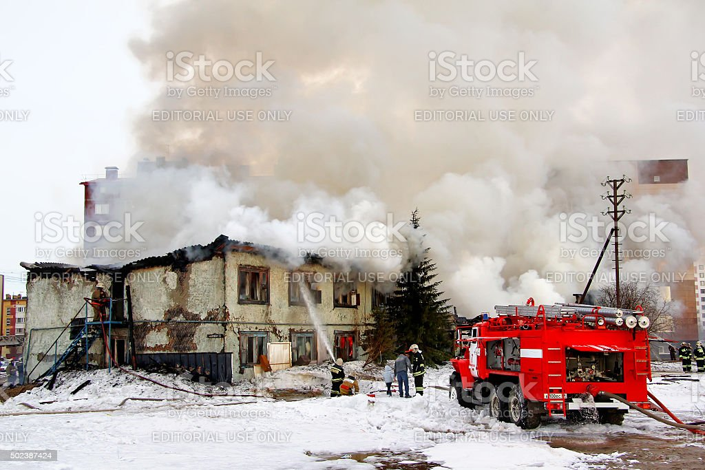 Fire in an old house stock photo