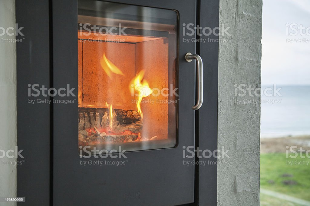 Fire in the stove stock photo