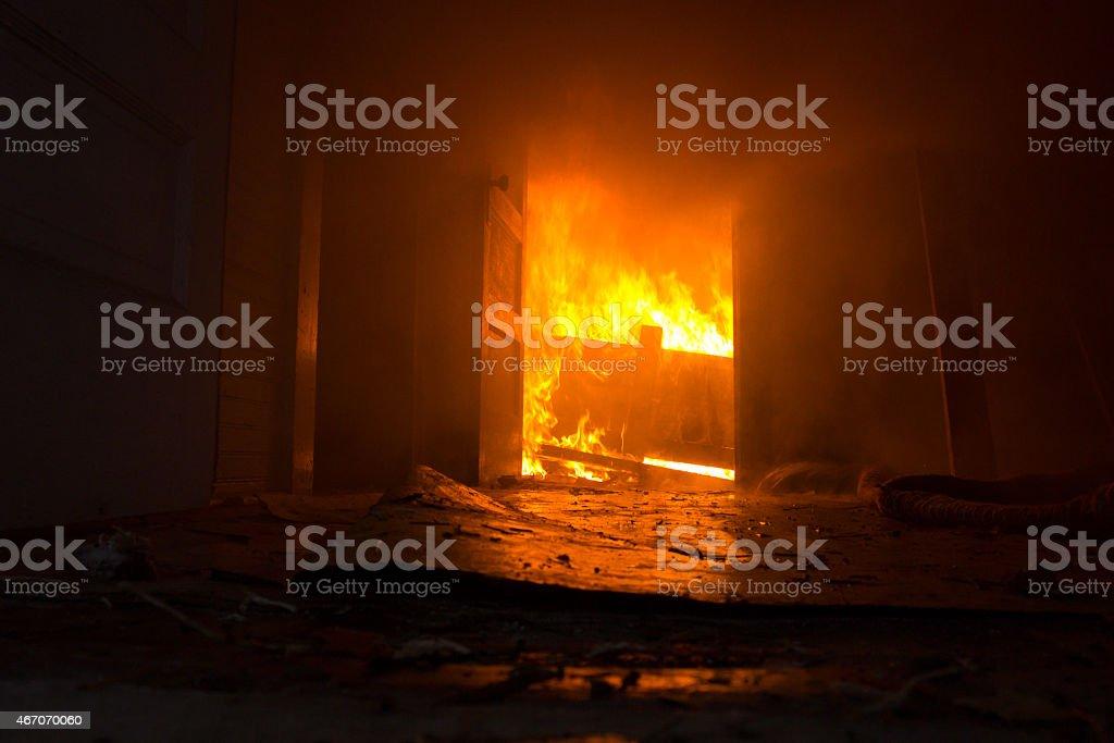 Fire inside door way of house stock photo