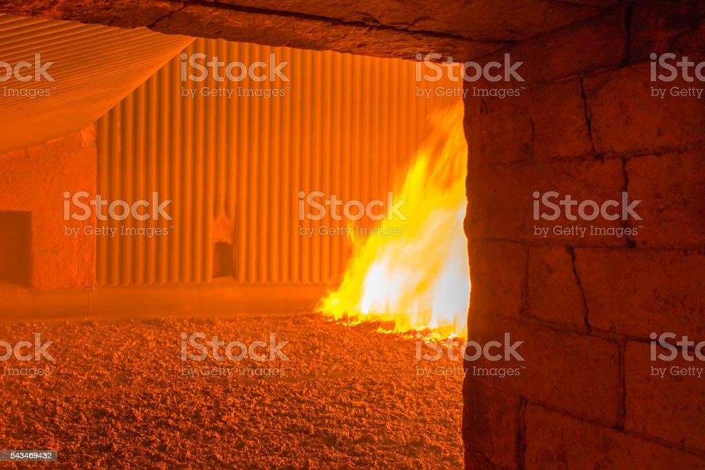 fire inside the coal boiler grate stock photo