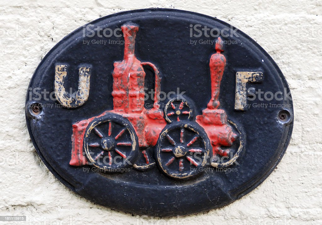 Fire insurance plaque from 18th century attached to building royalty-free stock photo