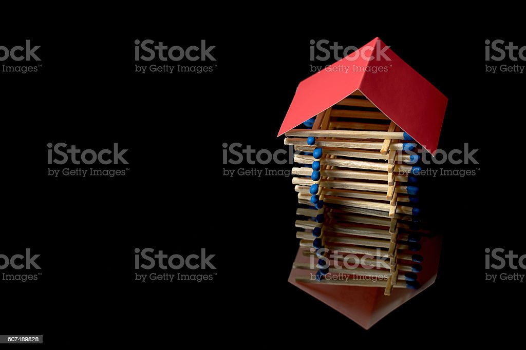Fire insurance. Wooden house insurance. Safe house. stock photo