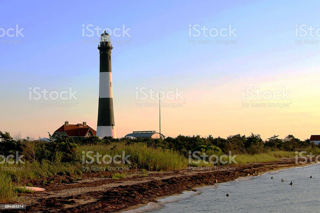 Fire Island Lighthouse taken from the boardwalk at dusk stock photo