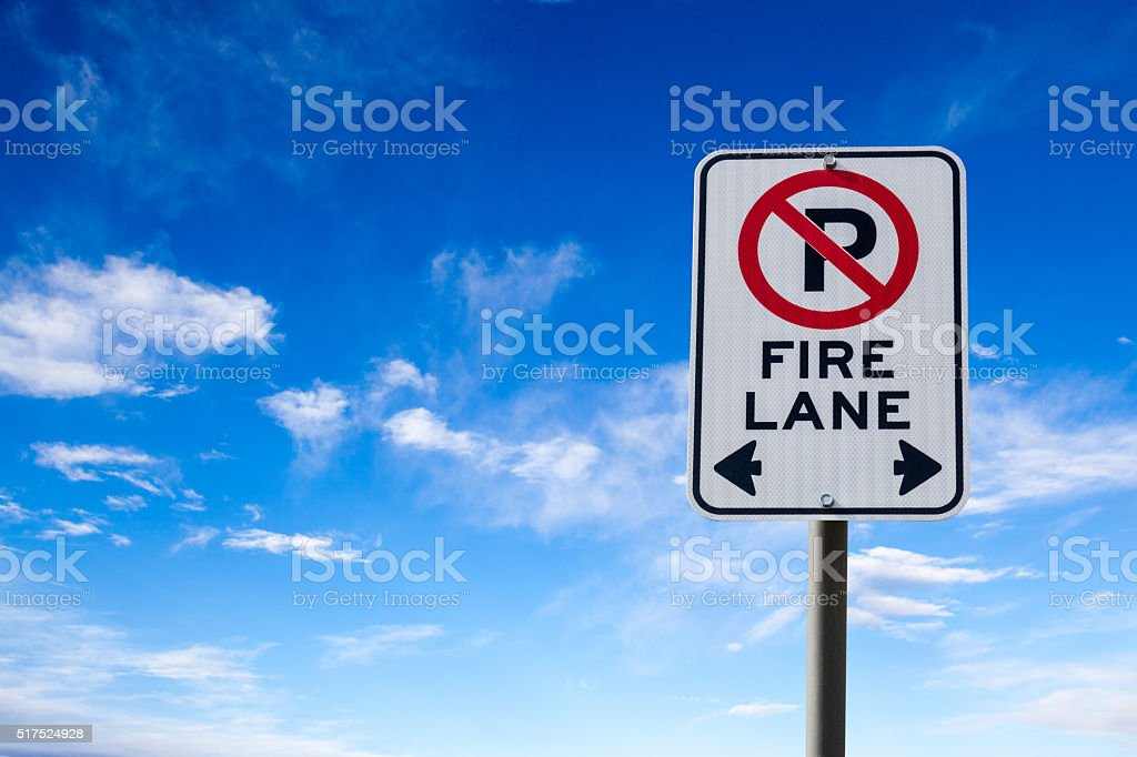 Fire Lane No Parking Sign Against Blue Sky stock photo