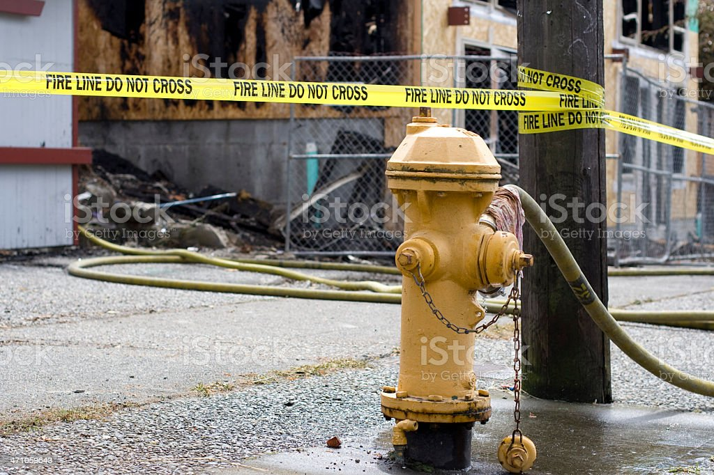 Fire line do not cross at burned out building stock photo