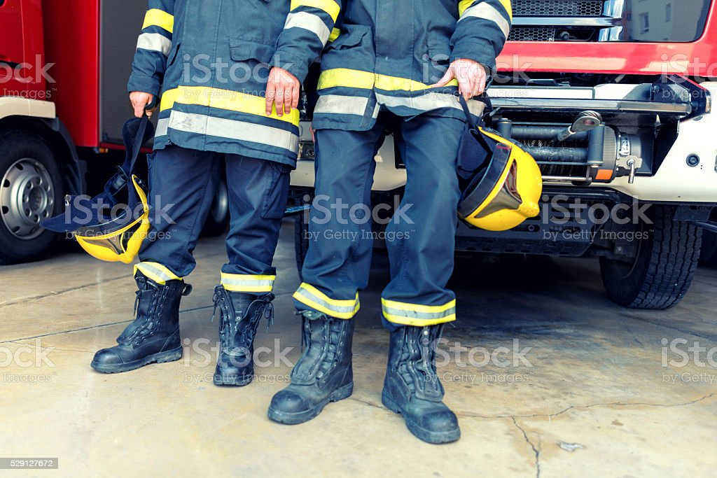Fire man boots and hat stock photo