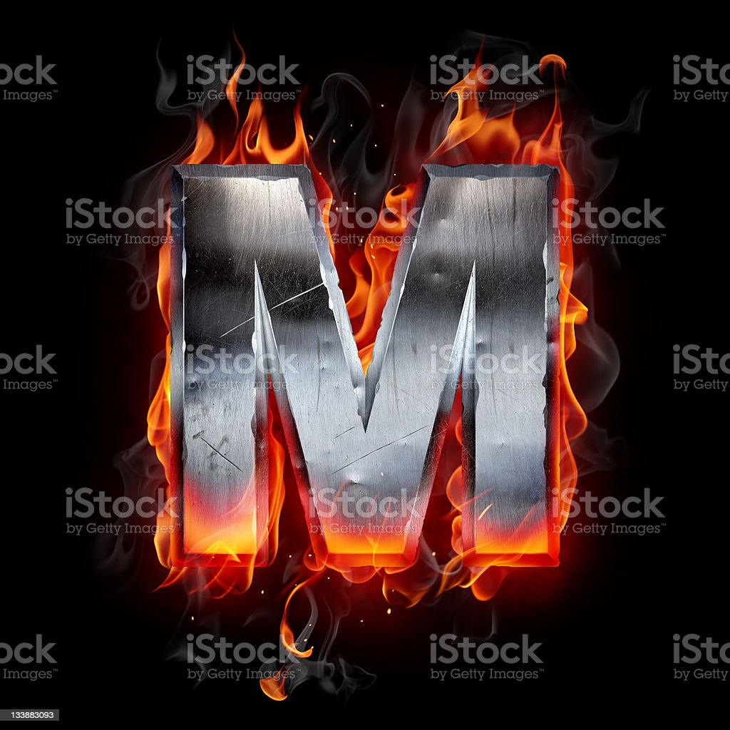 Fire metal font of the letter M over black background royalty-free stock photo