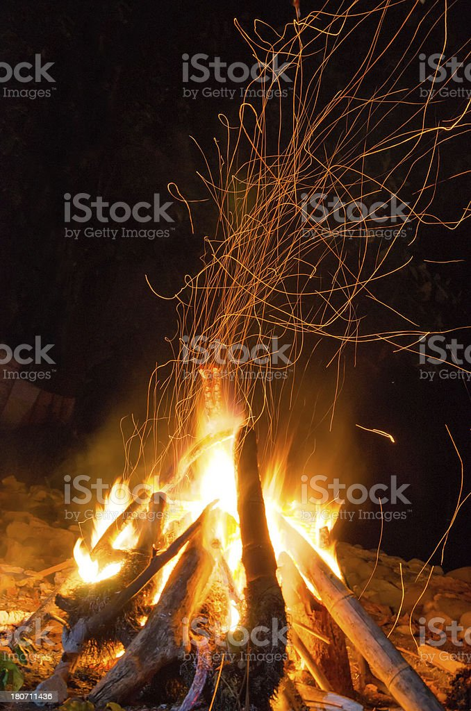 fire of a campfire with flying sparks stock photo