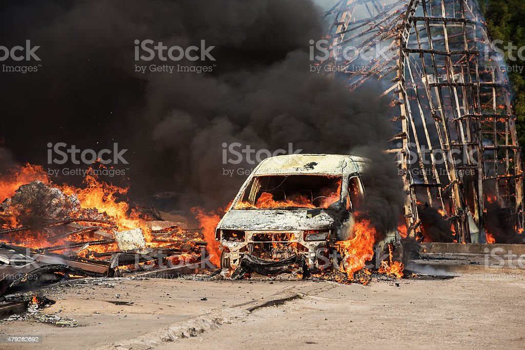 Fire of buildings and cars stock photo