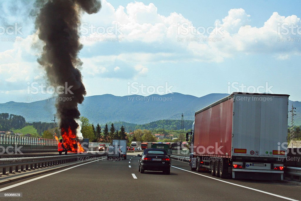 fire on highway royalty-free stock photo