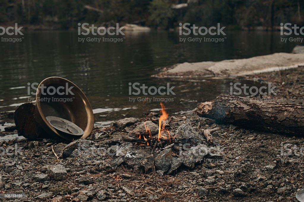 fire on the lake where gold is mined stock photo