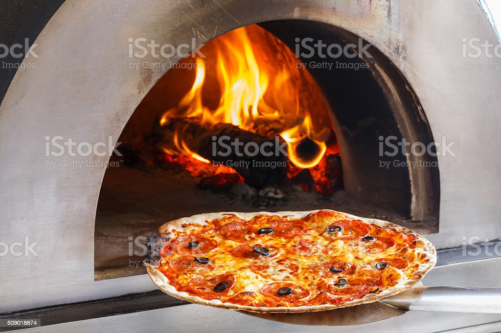 Fire oven pizza stock photo