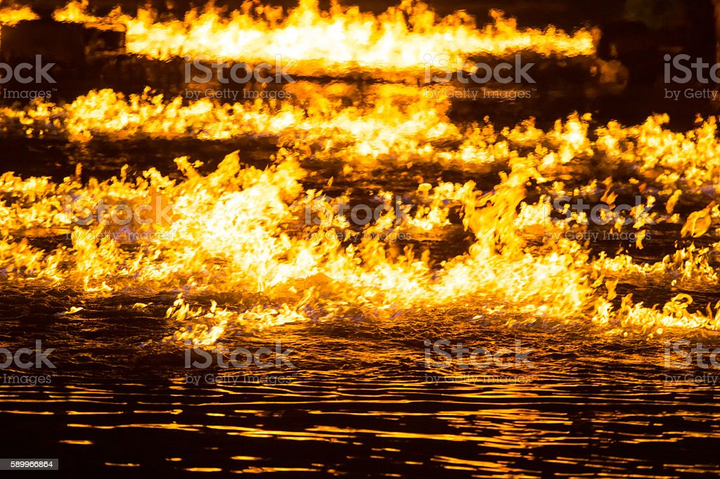 Fire over water stock photo