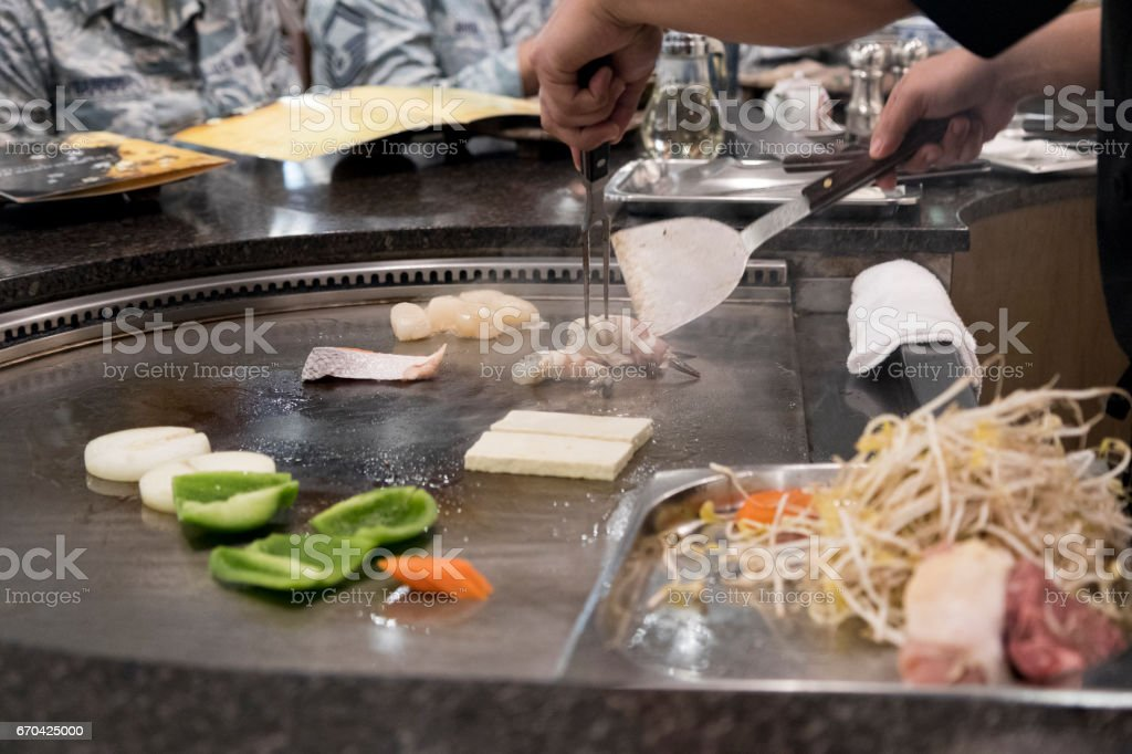 fire performance during cooking tepanyaki stock photo