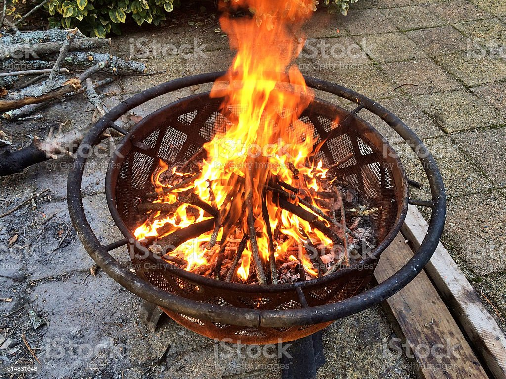 fire pit burning wood stock photo