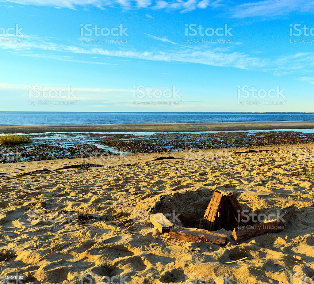 Fire pit on a beach, Cape Cod, Massachusetts royalty-free stock photo