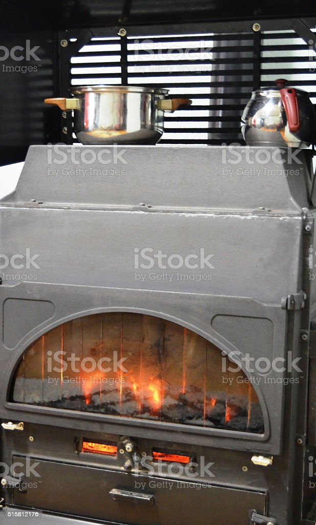 fire place with cooking pots stock photo